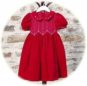 Girl's velvet dress with smocking from Abella
