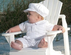 Baby boy's white romper suit
