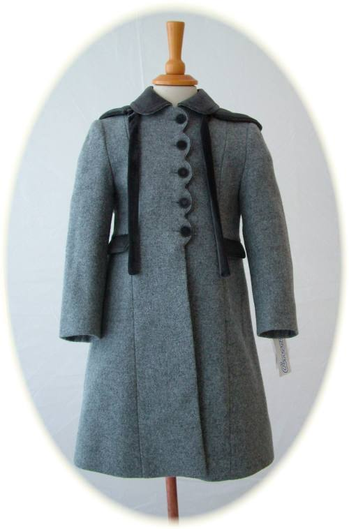 Girls traditional winter coats with hood and velvet trim.