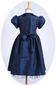 Child's smocked party dress back view