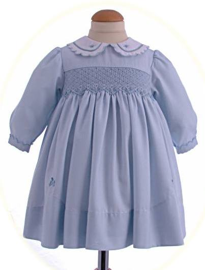 fead0ce88 Baby s hand smocked winter dress with long sleeves. • Baby Classics