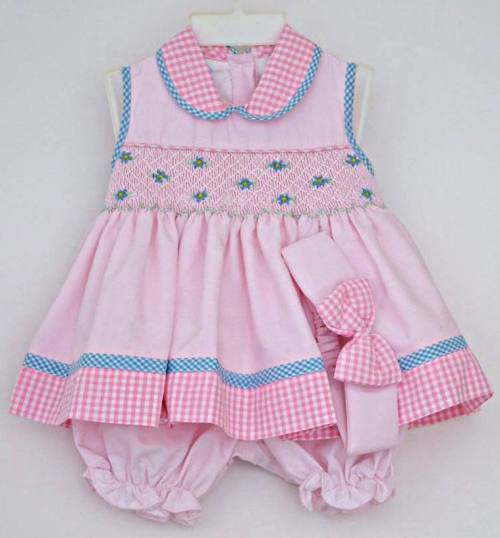 b5896d0423e1 Smocked baby dress with matching bloomers and headband.